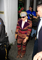 Lady Gaga worked a major '70s vibe in this printed pantsuit with wide purple velvet lapels while out in Hollywood.