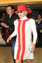 Lady Gaga was hardly incognito in her bright red hat and square shades while making her way through LAX.