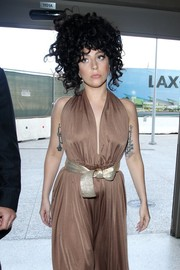 Lady Gaga teamed a gold belt with a bronze halter dress for a festive airport look.