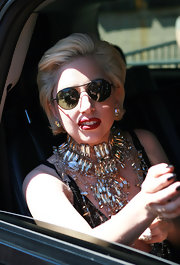Lady Gaga added some major bling to her look with a crystal embellished collar necklace.