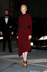 Tilda Swinton wore this Merlot draped dress to the Lanvin fashion show in Paris.
