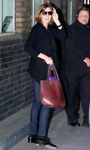 Laura Carmichael left London Studios carrying a large leather shopper bag.