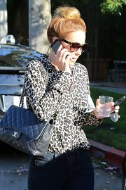 LC took her ladylike look from chic to Chanel with this classic quilted bag.