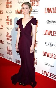 Mia Wasikowska arrived at the premiere of 'Lawless' wearing a plum textured silk cloque gown with a deep v-neck.