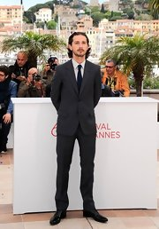 Shia LaBeouf chose a dapper charcoal suit for the 'Lawless' photocall in Cannes.