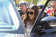 Lea Michele kept the rays out with a pair of oversized cateye sunnies by Thierry Lasry while leaving Au Fudge.
