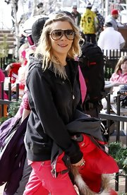 LeAnn Rimes heads out in Snowmass Village wearing a pair of cool shades along with her wintry ensemble.