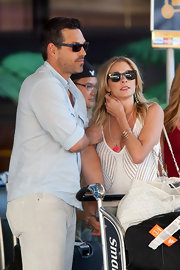 LeAnn Rimes arrived at LAX airport wearing a variety of Rosé bangles.