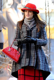 Leighton wears classic black leather gloves for this stylish winter ensemble.