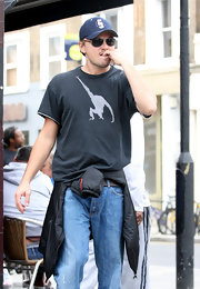 Leonardo DiCaprio biked around Notting Hill wearing a comfy old tee and jeans.