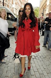 Leona Lewis was out and about in a flirty red trench paired with ruby heels and tousled tresses.