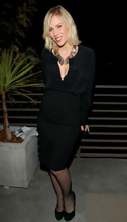 Natasha Bedingfield brightened up her LBD with this luminous gold statement necklace.