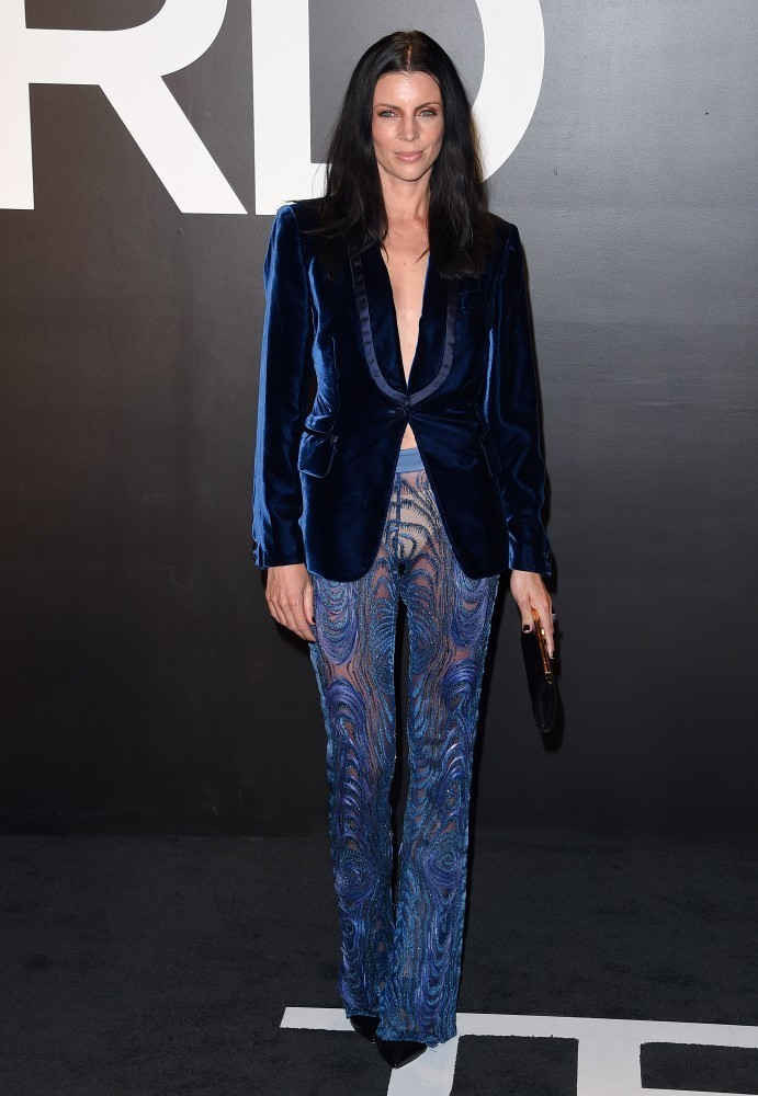 Liberty Ross went for an androgynous vibe in a blue velvet blazer by Tom Ford for