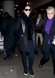 Liberty Ross looked casual but cool in this black leather coat while out at LAX.