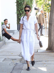 Lily Aldridge teamed her dress with flat black mules by Jenni Kayne.