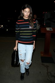 Lily Aldridge went for a grunge-chic finish with a pair of faded, ripped jeans.