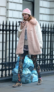 Lily Cole stepped out on a cold London day wearing a fluffy pink and white fur coat.