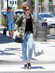 Lily Collins teamed her jacket with faded blue boyfriend jeans.