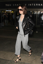 Underneath her jacket, Lily Collins wore a stylish gray B Collection by Bobeau wrap top.