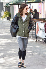 Lily Collins was spotted out on a stroll wearing a padded army-green jacket with black leather sleeves.