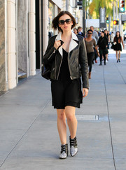 Lily Collins walked Rodeo Drive looking tough-chic in a monochrome leather jacket layered over an LBD.