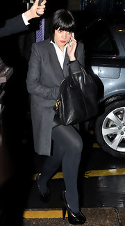 Lily Allen showcased her classic style with a leather shoulder bag.