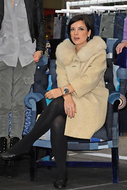 Lily Allen paired her chic fur lined coat with quilted ballet flats.