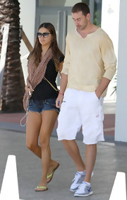Adriana Lima accessorized her look with a blush colored animal print scarf.