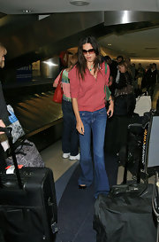 These oversized shades are the perfect shield against photographers when arriving after a long flight.