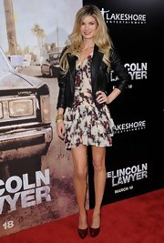 Marisa wears a cropped leather jacket with her flirty floral skirt for 'The Lincoln Lawyer' premiere.