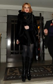 LiLo kept warm in a pair of sheer tights and tall platform boots.