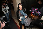 While making her way out of a chaotic situation, we couldn't help but notice Lindsay's grey patent leather tote.