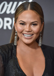 Chrissy Teigen opted for a sleek center-parted hairstyle when she attended the 'Lip Sync Battle LIVE: A Michael Jackson Celebration.'