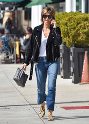 Lisa Rinna stepped out in Los Angeles wearing a black velvet moto jacket over a white shirt.