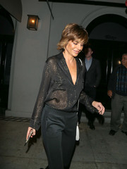 Lisa Rinna enjoyed a date night at Craig's wearing a sheer black blouse with gold pinstripes.