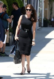Lisa Vanderpump styled her dress with edgy-glam studded black pumps by Christian Louboutin.