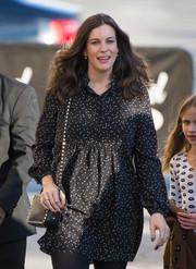Liv Tyler complemented her dress with the coveted Valentino Rockstud leather bag, in black.