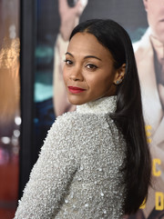 Zoe Saldana sported a minimally styled center-parted 'do at the LA premiere of 'Live by Night.'