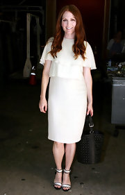 Julianne Moore was stunning in a white ruffled chiffon day dress for her visit to 'Live! With Regis and Kelly.' Ankle-strap heels a vibrant red waves finished off her look.