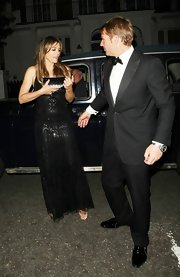 Elizabeth's black rectangular clutch was a minimal and sophisticated accessory to her beaded black gown.
