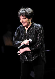 Liza Minnelli definitely knows how to dress for her age as she picked a pair of slacks and a beautiful sequined top to wear at a concert in London.