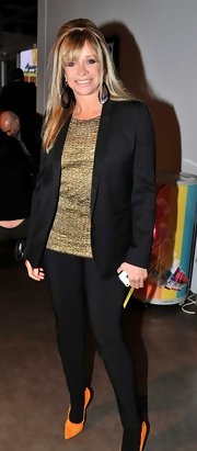 Jo Wood kept her outfit simple with black skinny pants, a gold top and to complete the look a black blazer.
