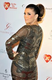 A bouncy high ponytail was an unexpected choice for Eva Longoria's ultra-glamorous (and sheer) beaded dress.
