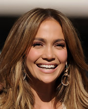 Jennifer Lopez paired her flowing curls with Looping Shine earrings in white and pink gold with diamonds and crystal.