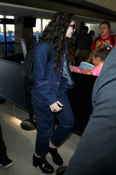 Chunky black booties completed Lorde's airport look.
