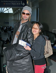 Josh Holloway did his best Brad Pitt impersonation in classic aviators, a knit beanie and beard.