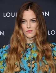 Riley Keough sported long, boho-style waves during the Louis Vuitton Series 2 exhibition.