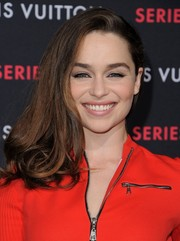 Emilia Clarke attended the Louis Vuitton Series 2 exhibition wearing a high-volume side sweep.