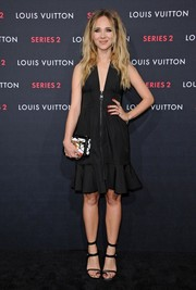 Juno Temple broke up the black theme with her Louis Vuitton Épi Petite Malle box clutch.