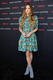 Riley Keough attended the Louis Vuitton Series 2 exhibition wearing a print dress that was conservative in cut yet bold in color.